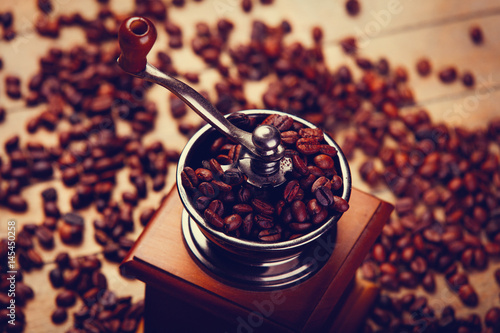 Papiers peints Café en grains photo of coffee grinder and roasted beans on the wonderful brown wooden background