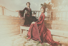 Two Sexy Ladies In Vintage Clothes On A Boat. Luxury And Glamour