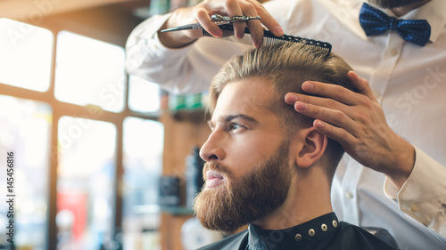 Fotografie, Obraz  Young Man in Barbershop Hair Care Service Concept