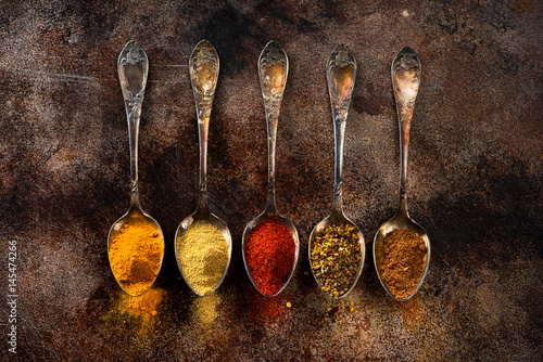 Canvas Prints Spices Ground Spices and herbs in old spoons