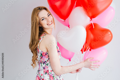 Girl in romantic dress with balloons in the shape of a heart Poster