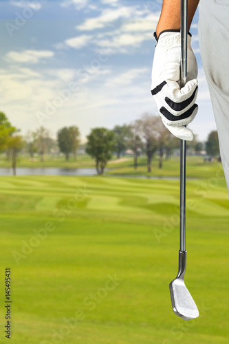 Fotobehang Golf Golf player holding a golf club in golf course