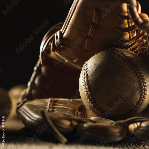 Photo  Close up image of an old used baseball