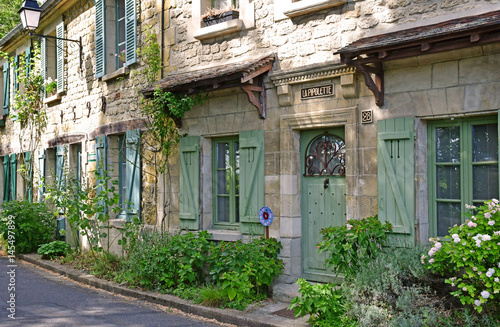Auvers sur Oise , France - august 14 2016 : picturesque village in summer Wallpaper Mural