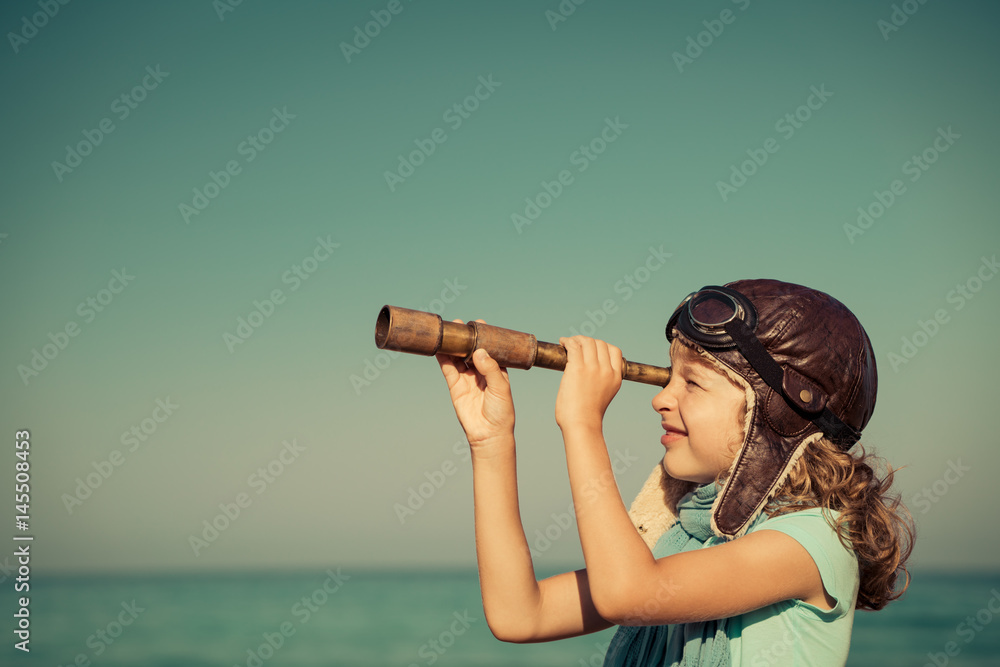 Fototapety, obrazy: Happy kid playing outdoor against sea and sky