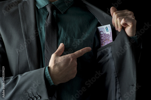 Fotografiet  Conceptual image of businessman showing money