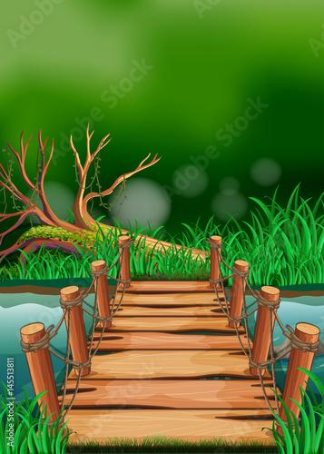 scena-z-drewnianym-mostem-na-rzece