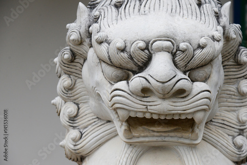 Fotografie, Tablou  Chinese stone lion statue architecture guardian in chaina culture