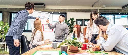 Obraz Brainstorming in a startup office - fototapety do salonu