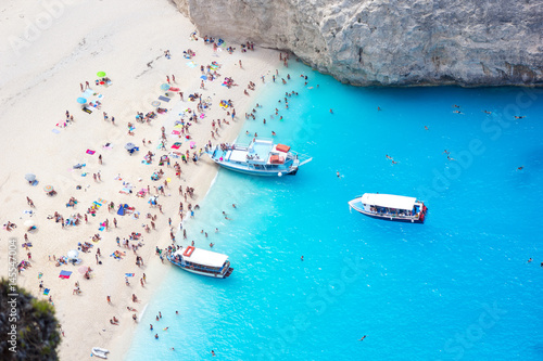 Rental boats near beach with people Zakynthos, Navagio Canvas Print