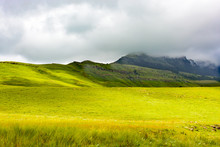 Color Panorama Scenic Landscape Photo Of South Africa Drakensberg Scenic Nature, Green Plane And Mountains In Dense Clouds On A Sunny Day