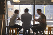 canvas print picture - Rear View Of Three Male Friends Meeting In Coffee Shop
