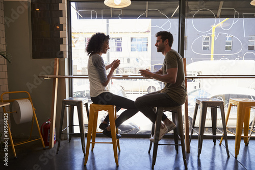Valokuva  Couple Meeting For Date In Coffee Shop