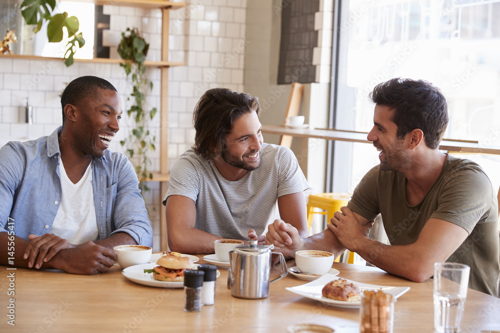 Fototapeta Three Male Friends Meeting For Lunch In Coffee Shop