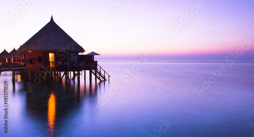 Poster Océanie Water bungalow. Water bungalows on the islands of the Maldives. A place to relax and honeymoon.