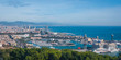 Beautiful Blue commerce. Coastline of Spain in seaside Barcelona. Modern city scape & coastline as seen from high level, cable car over the city.