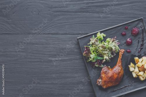 Poster Klaar gerecht Roasted duck leg, restaurant food closeup