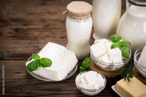 Poster Dairy products Fresh dairy products on the wooden table