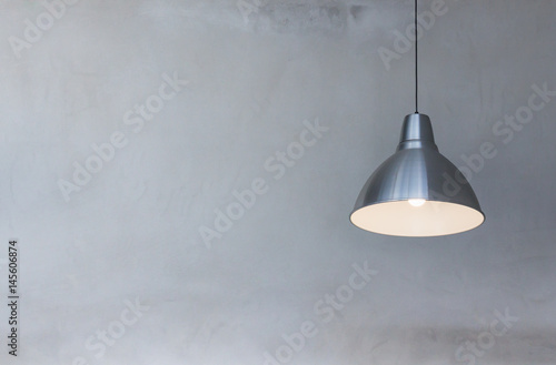 metal hanging lamp on concrete wall background Canvas Print