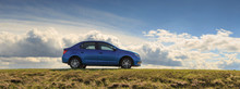 GOMEL, BELARUS - 16 April 2017: Beautiful Blue Car Against The Sky With Clouds