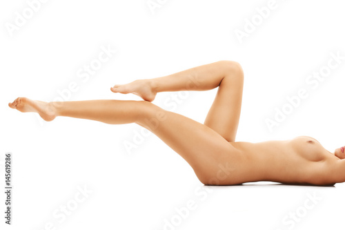 Sexy fit naked woman isolated on white