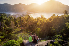 A Couple Admiring The Sunset On Phi Phi Island
