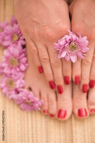 Canvas Prints Pedicure female feet and hands at spa salon