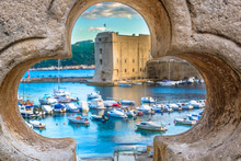 Dubrovnik Scenery. / Old Stone Hole With Dubrovnik Scenery In Background, Croatian Travel Places.