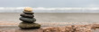 canvas print picture - Stein Stapel am Strand Panorama