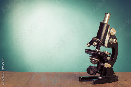 Stampa su Tela  Vintage old microscope on table for science background