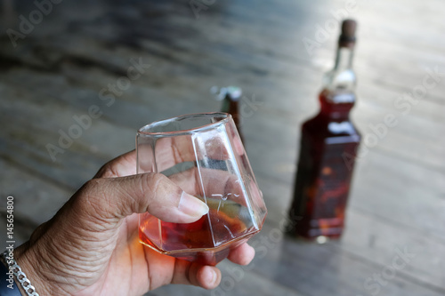Local whiskey in a glass with bottle of herbal liquor. Wallpaper Mural