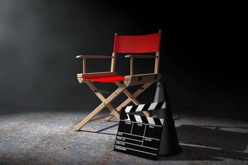 Cinema Industry Concept. Red Director Chair, Movie Clapper and Megaphone in t...