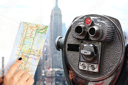 Map Of New York Rockefeller Center.Traveler Holding City Map In Front Of Empire State Building New