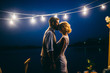 Leinwanddruck Bild - Amazing wedding couple near the river at night