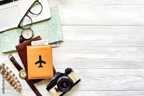 Obraz na płótnie travel and wanderlust concept, planning summer vacation background flat lay, space for text map compass photo camera sunglasses wallet watch laptop on white wooden table top view