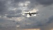 View from the beach on the landing airplane isolated over beautiful cloudy dramatic looking sky background - video in slow motion