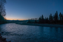 Fast Flowing River On The Background Of The Evening Sky. Dark Blue Rough River. Scenic Landscape Of Olympic National Park, Washington State, USA