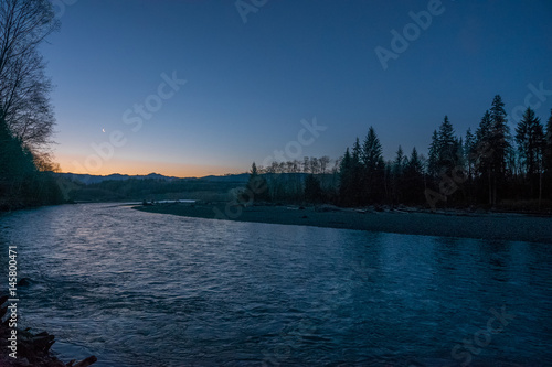 Printed kitchen splashbacks River Fast flowing river on the background of the evening sky. Dark blue rough river. Scenic landscape of Olympic National Park, Washington state, USA