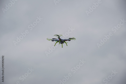 Canvas Print white droid flying with a cloudy background