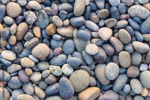 Photo  Small sea stones, gravel. Background. Textures
