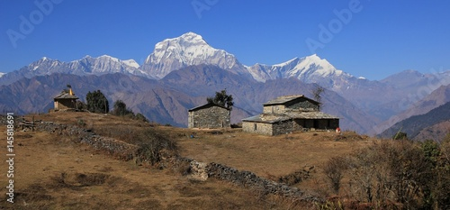 Staande foto Nepal View from a place near Gorepani, Nepal. Old farmhouse and shed. Dhaulagiri range.