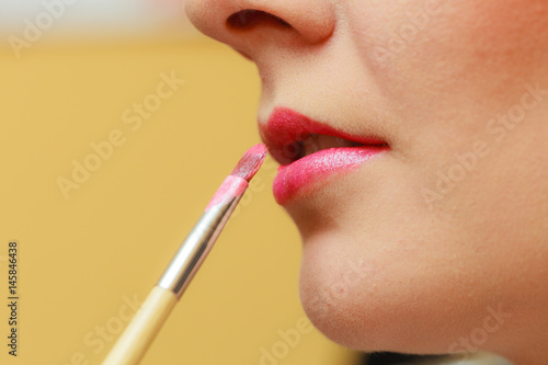 Close up woman getting make up, lips Tableau sur Toile