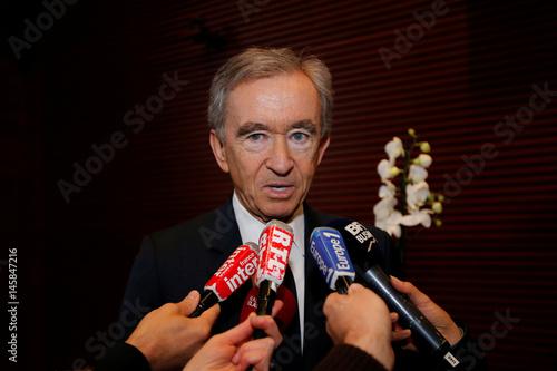 Chairman and CEO of Luxury goods group LVMH Bernard Arnault talks to