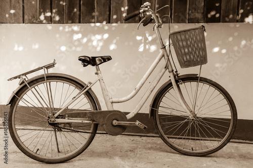 Deurstickers Fiets a vintage bicycle, sepia tone
