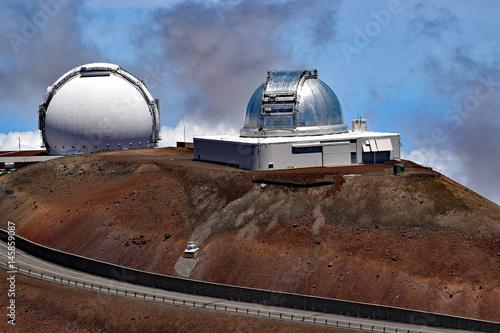 The Subaru telescope and the Keck telescope   near the summit of Mauna Kea Poster