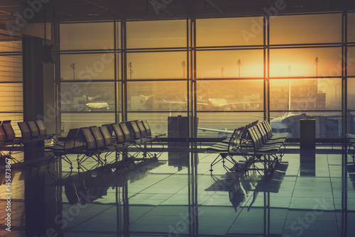 Poster Aeroport Silhouette of an empty airport terminal during sunrise. Travel Concept. Vintage colors