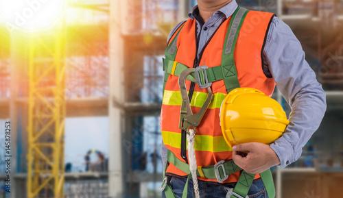 Fotografie, Obraz  engineer wear fall arrest equipment on site  background