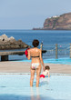 Mom with a child in the pool in Ribeira Brava. Madeira Island. Portugal