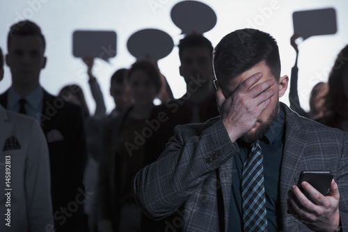 Fototapety, obrazy: Man covering his face