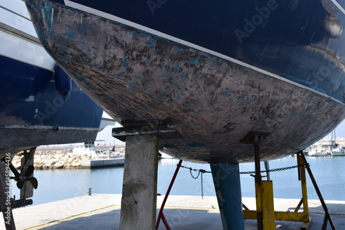 Fotografia, Obraz  stilts holding a boat for maintenance and repair